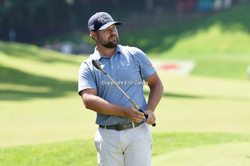 August 5, 2016:  Ryan Moore watches his chip shot to the 15th green during day two of the PGA Travelers Championship held at TPC River Highlands in Cromwell CT. Eric Canha/CSM