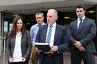 Pictured: DCI Rob Conick of South Wales Police (3rd L)with  DC Sue Davies (L) and other colleagues, reads a statement on the steps of Swansea Crown Court.<br />