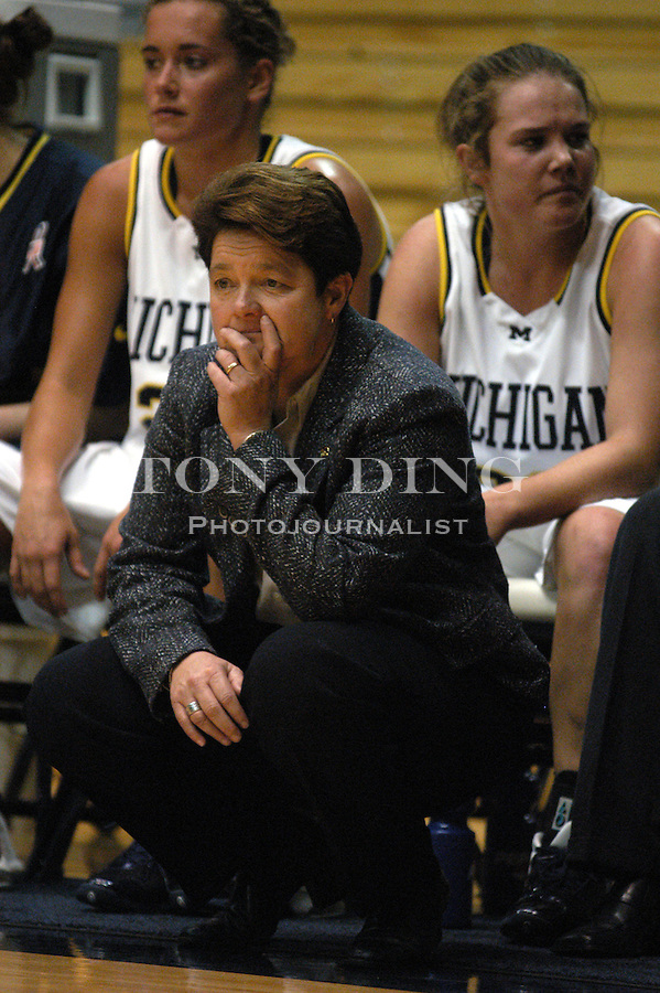 Michigan Womens Basketball Head Coach Sue Guevara watches nervously as a Michigan player preps for a free-throw during the Wolverine's matchup against Creighton University on Friday, November 22, 2002 in Crisler Arena (Tony Ding/Daily).