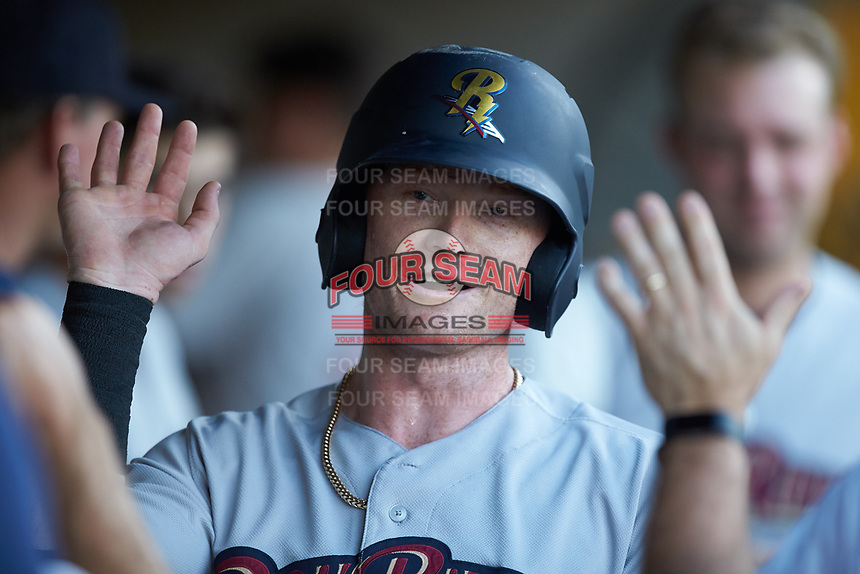 Clint Frazier (77) of the Scranton/Wilkes-Barre RailRiders is congratulated by his teammates after scoring a run against the Gwinnett Stripers at BB&T BallPark on August 16, 2019 in Lawrenceville, Georgia. The Stripers defeated the RailRiders 5-2. (Brian Westerholt/Four Seam Images)