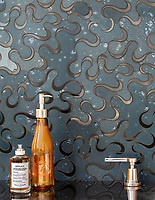 Evelyn, a waterjet stone mosaic, shown in honed Orchid Basalto and polished Nero Marquina, is part of the Bright Young Things™ collection by New Ravenna.