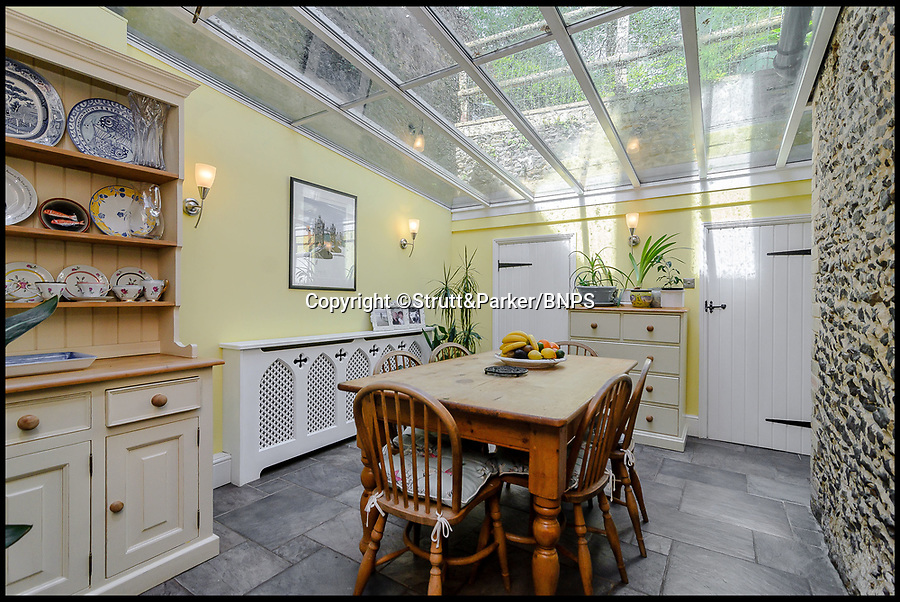 BNPS.co.uk (01202 558833)<br /> Pic: Strutt&Parker/BNPS<br /> <br /> Good enough to eat!<br /> <br /> A fairytale-style home that looks like it could be made out of gingerbread has gone on the market for £1.25m.<br /> <br /> The quaint and quirky Firbank House was once the coachhouse and stables for a country mansion before it was turned into a home in the 1950s.<br /> <br /> The Grade II listed period property has a Victorian Gothic style, with lots of ornate decorative touches, including a cupola and a decorative slate roof with fleur-de-lys ridge cresting that look like something you'd see on a gingerbread house.<br /> <br /> The five-bedroom house in Tilford, Surrey, is now on the market with estate agents Strutt & Parker.