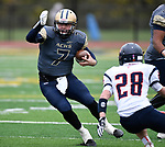 Althoff quarterback Hayes Taylor (7, left) zig-zags as Carterville's Justin Cross (28) moves in on him. The Althoff Catholic High School Crusaders defeated the Carterville Lions 42-0 in a first-round Illinois High School Association Class 4A football playoff game on Saturday October 28, 2017 in Belleville.