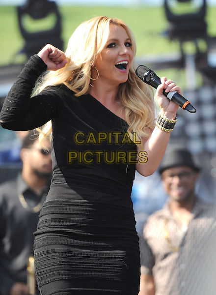 Britney Spears .Performing at The 2013 KIIS FM Wango Tango held at The Home Depot Center in Carson, California, USA, May 11th 2013..music  concert show gig live on stage microphone half length one shoulder sleeve dress black smiling singing hand fist .CAP/DVS.©Debbie VanStory/Capital Pictures
