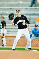 Wake Forest Demon Deacons first baseman Matt Conway (25) waits for a throw during the game against the North Carolina Tar Heels at Wake Forest Baseball Park on March 9, 2013 in Winston-Salem, North Carolina.  The Tar Heels defeated the Demon Deacons 20-6.  (Brian Westerholt/Four Seam Images)
