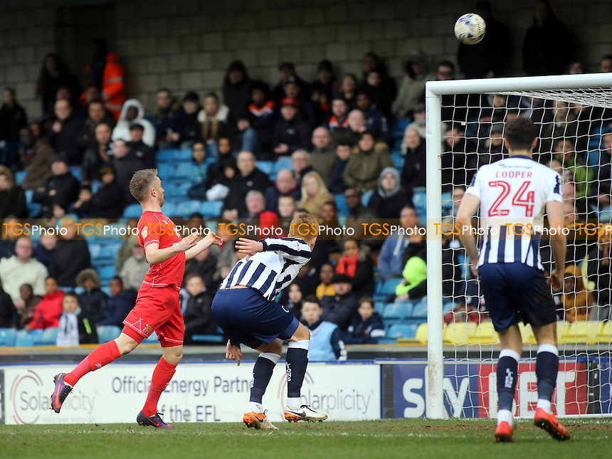 Dean Bowditch of MK Dons heads the ball over the Millwall crossbar during Millwall vs MK Dons, Sky Bet EFL League 1 Football at The Den on 4th March 2017