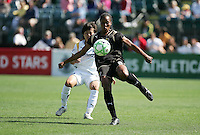 Kandace Wilson (9) kicks the ball ahead of Aya Miyama (left). Los Angeles Sol defeated FC Gold Pride 2-0 at Buck Shaw Stadium in Santa Clara, California on May 24, 2009.
