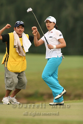 February 18, 2006; Kahuku, HI - Joo Mi Kim celebrates on the 18th green after making a birdie putt on the second playoff hole to win the LPGA SBS Open at Turtle Bay Resort...Lorena Ochoa and Soo Young Moon (both not pictured) were the other two players in the playoff...Mandatory photo credit: Darrell Miho.© Darrell Miho