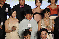 """HONG KONG - MARCH 22:  Hong Kong actor Jackie Chan (C) and Chinese actresses Fan Bingbing (L) and Xu Jingle attend the Opening Ceremony of the 33rd Hong Kong International Film Festival and the Gala Premiere of the opening films """"Shinjuku Incident """" at the Hong Kong Convention and Exhibition Centre on March 22, 2009 in Hong Kong.  Photo by Victor Fraile / studioEAST"""