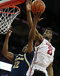 Wisconsin Badgers guard Khalil Iverson (21) blocks a shot from Michigan Wolverines guard Muhammad-Ali Abdur-Rahkman (12) at the Kohl Center. Mandatory Credit: Mary Langenfeld-USA TODAY Sports