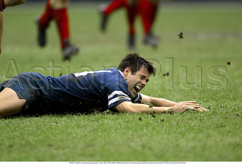 KENNY LOGAN on the ground injured, France 38 v SCOTLAND 3, RBS Six Nations Championship, Stade De France, Paris 030223 Photo:Glyn Kirk/Action Plus...Rugby Union 2003.player scottish injury