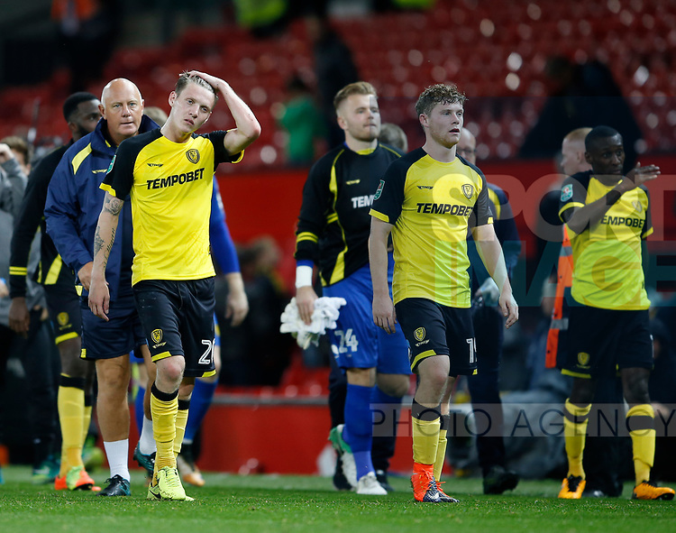 Burton players troop off dejected during the Carabao Cup Third Round match at the Old Trafford Stadium, Manchester. Picture date 20th September 2017. Picture credit should read: Simon Bellis/Sportimage