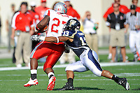 9 October 2010:  FIU linebacker Toronto Smith (13) tackles Western Kentucky fullback Rod Johnson (27) in the second quarter as the FIU Golden Panthers defeated the Western Kentucky Hilltoppers, 28-21, at FIU Stadium in Miami, Florida.