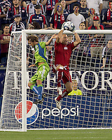 New England Revolution goalkeeper Matt Reis (1) grabs pass to Seattle Sounders FC forward Roger Levesque (24). The New England Revolution defeated the Seattle Sounders FC, 3-1, at Gillette Stadium on September 4, 2010.