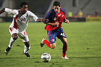 United Arab Emirates' Abdulaziz Hussain (20) chases down Costa Rica's Bryan Oviedo (14) during the FIFA Under 20 World Cup Quarter-final match at the Cairo International Stadium in Cairo, Egypt, on October 10, 2009. Costa Rica won the match 1-2 in overtime play.