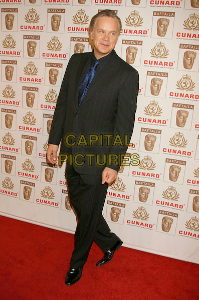TIM ROBBINS.The 2006 BAFTA/LA Cunard Britannia Awards held at the Century Plaza Hotel, Los Angeles, California, USA..November 2nd, 2006.Ref: ADM/RE.full length black suit .www.capitalpictures.com.sales@capitalpictures.com.©Russ Elliot/AdMedia/Capital Pictures.