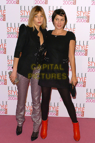 JEMIMA FRENCH & SADIE FROST.Elle Style Awards 2006 - Arrivals,.Atlantis Gallery, Old truman Brewery, Brick Lane, London, England,.February 20th 2006..full length red ankle boots black dress tights silver trousers.Ref: CAN.www.capitalpictures.com.sales@capitalpictures.com.©Capital Pictures