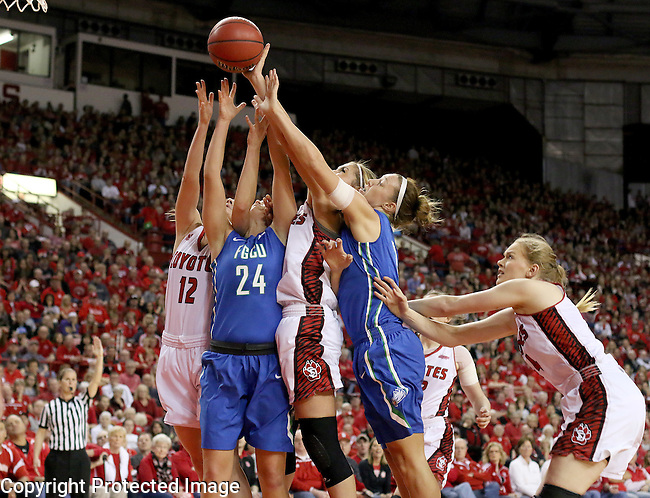 VERMILLION, SD, APRIL 2:  Taylor Gradinjan #24 and Katie Meador #3 from Florida Gulf Coast battle for the rebound with Jaycee Bradley #12 and Caitlin Duffy #33 from the University of South Dakota during the WNIT Championship game Saturday afternoon at the Dakota Dome in Vermillion, S.D. (Photo by Dave Eggen/Inertia)