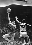 25 MAR 1961:  Ohio State's Jerry Lucas (11) and Cincinnati center Paul Hogue (22) during the NCAA Men's Basketball National Championship held at Kansas City, MO. Cincinnati defeated Ohio State 70-65 in overtime for the title. Photo Copyright Rich Clarkson