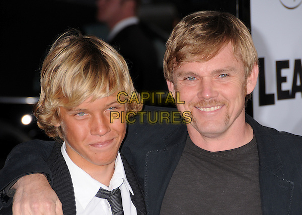 "LUKE & RICK SCHRODER.""Leatherheads"" Los Angeles Premiere at Grauman's Chinese Theatre, Hollywood, California, USA..March 31st, 2008.headshot portrait ricky father dad family arm over shoulder black moustache mustache facial hair .CAP/ADM/BP.©Byron Purvis/AdMedia/Capital Pictures."