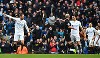 Swansea City's Jack Cork (right) and Swansea City's Gylfi Sigurdsson (left) speak with Referee Mike Dean (second right) as Manchester City's Gabriel Jesus scores the second goal during the Premier League match between Manchester City and Swansea City at the Etihad Stadium, Manchester, England. Sunday 05 February 2017