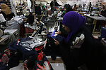 Palestinian women work at  clothing factory in the West Bank City of Qalqilya, on March 7, 2019. The factory is owned by Palestinian businesswoman Fatima Al-Jedi, who started sewing 30 years ago with one sewing machine. Fatima Al-Jedi now owns five sewing workshops in five Palestinian cities, hiring more than 150 women workers. Photo by Shadi Jarar'ah