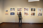National Geographic Young Explorer Hannah Reyes stands in front of her photographs documenting indigenous transitions and adaptations to Western-style modernity in the Philippines on exhibit at the Aa Haa West Gallery during the Mountainfilm Festival in Telluride, Colorado on May 22, 2015.