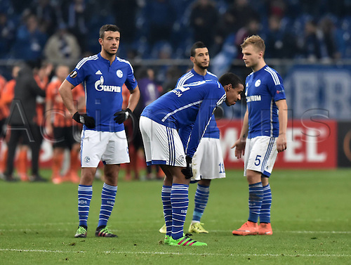 25.02.2016. Gelsenkirchen, Germany. Europa League Round of 32 Second Leg soccer match between Schalke 04 and FC Shakhtar Donetsk in the Veltins Arena in Gelsenkirchen, Germany. Klaas-Jan Huntelaar(Schalke 04) and Younes Belhanda (Schalke 04) wait to restart after another goal