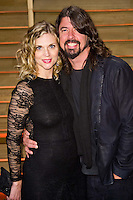 Dave Grohl and wife Jordyn Blum arriving for the 2014 Vanity Fair Oscars Party, Los Angeles. 02/03/2014 Picture by: James McCauley/Featureflash