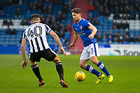 Oldham Athletic's Rob Hunt in action with Rochdale's Ian Henderson during the Sky Bet League 1 match between Oldham Athletic and Rochdale at Boundary Park, Oldham, England on 18 November 2017. Photo by Juel Miah/PRiME Media Images