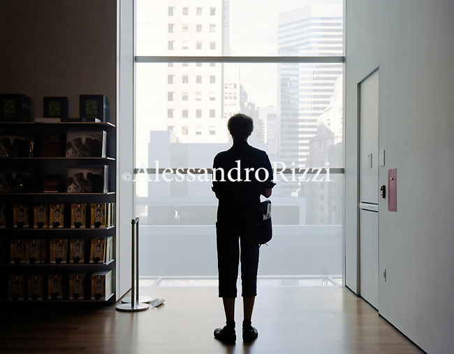 A man standing inside the Moma Museum in New York
