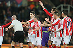 Stoke City players confront the referee to claim Sergio Aguero of Manchester City scored with his hand - Barclays Premier League - Stoke City vs Manchester City - Britannia Stadium - Stoke on Trent - England - 11th February 2015 - Picture Simon Bellis/Sportimage