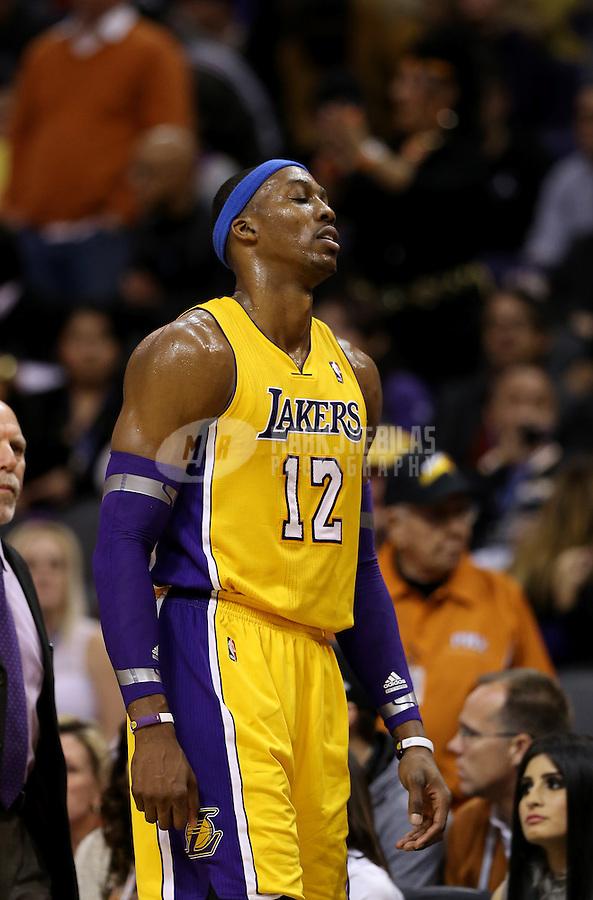 Jan. 30, 2013; Phoenix, AZ, USA: Los Angeles Lakers center Dwight Howard leaves the game after suffering an injury in the second half against the Phoenix Suns at the US Airways Center. The Suns defeated the Lakers 92-86.  Mandatory Credit: Mark J. Rebilas-