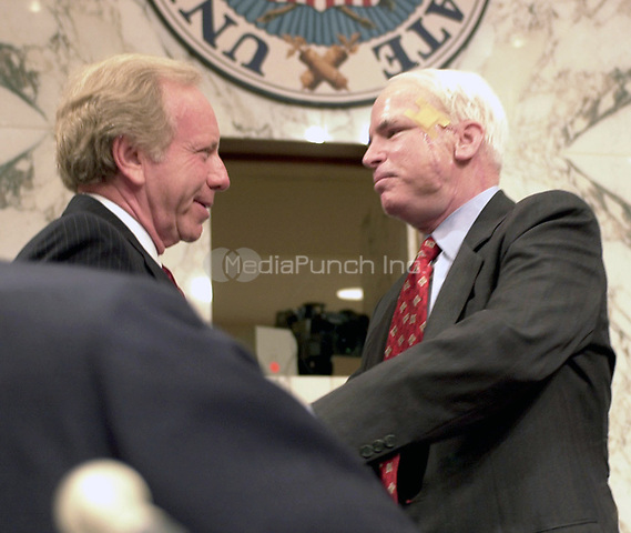 United States Senator John McCain (Republican of Arizona) hugs U.S. Senator Joseph Lieberman (Democrat of Connecticut), the 2000 Democratic Party nominee for Vice President of the United States, following the latter's testimony before the U.S. Senate Committee on Commerce, Science, and Transportation hearing on marketing Violence to Children in Washington, DC on September 13, 2000.<br /> Credit: Ron Sachs / CNP/MediaPunch