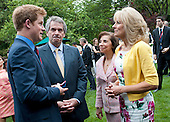 Prince Harry (L) and Sir Peter Westmacott (2nd-L), the British Ambassador to the United States, talk to Dr. Jill Biden (R), the wife of U.S. Vice President Joe Biden, during a reception for U.S. and British wounded warriors at the British Ambassador's Residence in Washington, D.C. on May 7, 2012.  .Credit: Kevin Dietsch / Pool via CNP