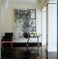 Shiny parquet covers the floor of the entrance hall which is graced with a painting by Sigmar Polke