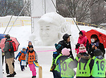 February 4, 2019, Sapporo, Japan - Visitors admire a snow sculpture of Australian Open tennis champion Naomi Osaka displayed at the 70th annual Sapporo Snow Festival in Sapporo in Japan's nortern island of Hokkaido on Monday, February 4, 2019. The week-long snow festival started at the Odori Park in central Sapporo through February 11 and over 2.5 million people are expecting to visit the festival.   (Photo by Yoshio Tsunoda/AFLO)