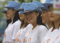 "A group of young Korean women greeted spectators with ""Welcome to smiling Korea!"" in English before entering the World Cup Opening Day Eve Festivities taking place in  Seoul, South Korea on Thursday May 30th, 2002. The World Cup will begin on Friday in Seoul with a match between defending champions France vs. Senegal."