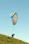 A paraglider pilot from Australia launches from Chelan Butte during the 2010 World Paragliding Championships.