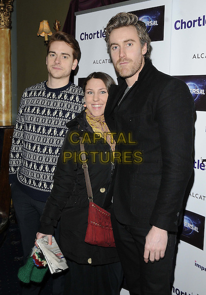 guests.attended the Chortle Comedy Awards 2013, Cafe de Paris, London, England..March 25th, 2013.half length black top pattern jumper sweater red bag purse stubble facial hair .CAP/CAN.©Can Nguyen/Capital Pictures.