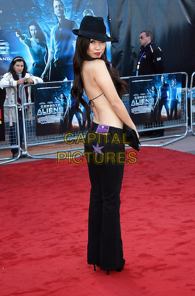 SELINA LO.UK Premiere of 'Cowboys and Aliens' at the Cineworld cinema at the O2 Arena, London, England..August 11th 2011.full length black hat top cloth sequins sequined clutch bag backless back behind rear string looking over shoulder stars purple.CAP/ROS.©Steve Ross/Capital Pictures