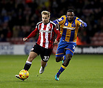 Harry Chapman of Sheffield United tussles with Sylvan Ebanks-Blake of Shrewsbury Town during the English Football League One match at Bramall Lane, Sheffield. Picture date: November 19th, 2016. Pic Jamie Tyerman/Sportimage