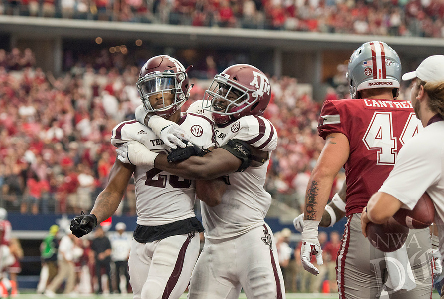 Hawgs Illustrated/BEN GOFF <br /> Armani Watts (23), Texas A&amp;M defensive back, and Otaro Alaka, Texas A&amp;M linebacker, cebebrate after the Texas A&amp;M defense stopped Arkanss from scoring to win in overtime Saturday, Sept. 23, 2017, during the Southwest Classic at AT&amp;T Stadium in Arlington, Texas.