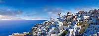 Panoramic view of traditional blue domed Greek Orthodox church of Oia, Island of Thira, Santorini, Greece.