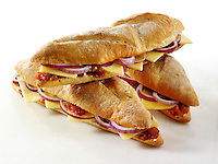 Ploughman's baguette, Cheddar cheese, red onion and pickle. Food photos.