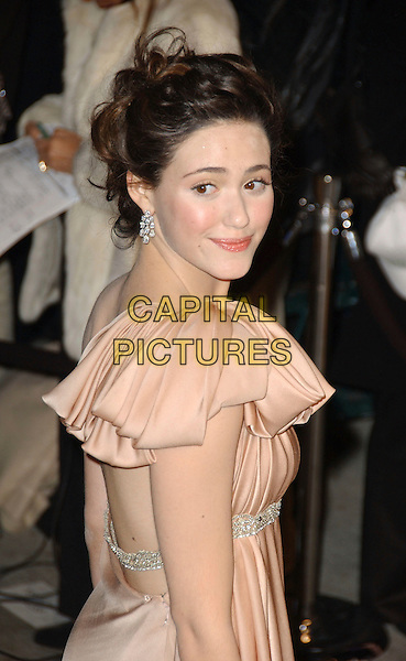 EMMY ROSSUM.The 2007 Vanity Fair Oscar Party Hosted by Graydon Carter held at Morton's, West Hollywood, California, USA, 25 February 2007..oscars half length looking over shoulder peach pleated dress.CAP/ADM/GB.©Gary Boas/AdMedia/Capital Pictures.