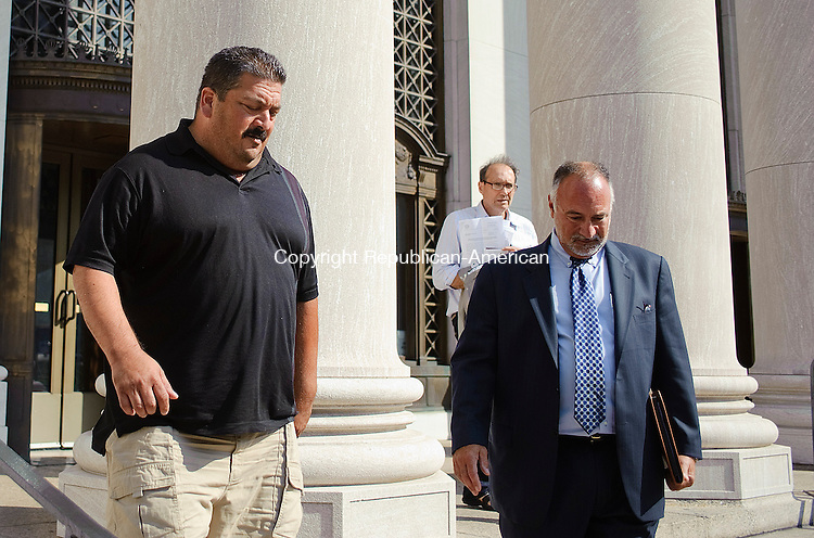 """NEW HAVEN, CT-26 JULY 2012--072612JS05- David """"Bufallo"""" Moffa of Middlebury, left, makes his way out of New Haven Federal Court on Thursday after pleading not guilty as part of an indictment to funnel illegal campaign donations to Chris Donovan's former campaign manager. .Jim Shannon Republican-American"""