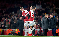 Charlie Gilmour of Arsenal replaces Mesut Ozil of Arsenal during the UEFA Europa League match between Arsenal and Qarabag FK at the Emirates Stadium, London, England on 13 December 2018. Photo by Andy Rowland.