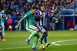 FC Barcelona's forward Luis Suarez competes for the ball with defender Theo Hernandez  during the match of La Liga between Deportivo Alaves and Futbol Club Barcelona at Mendizorroza Stadium in Vitoria, Spain. February 11, 2017. (ALTERPHOTOS/Rodrigo Jimenez)