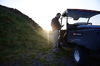 Superintendent Josh Lewis checks his phone in the early hours on the course. Chambers Bay Golf Course in University Place, Washington will host the 2015 U.S. Open in June 2015. Photo by Daniel Berman for Golf Course Management Magazine.